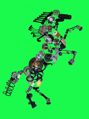 Many new spare parts in the form of a horse isolated on green background