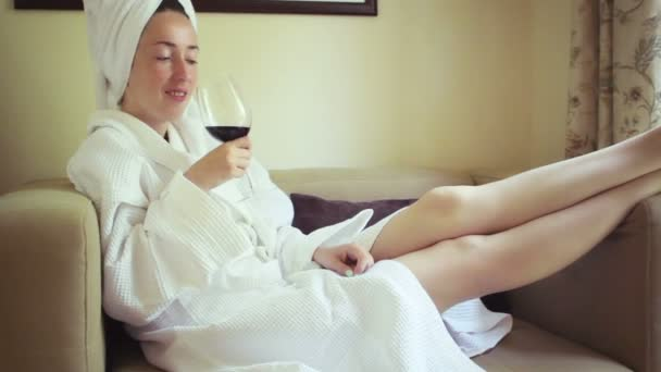 Young beautiful girl in a bathrobe