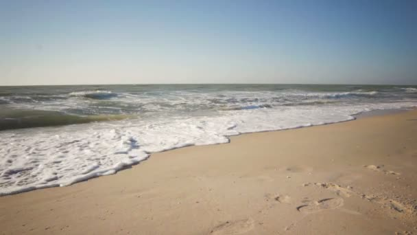 Summer time blue sea waves yellow sun and sand