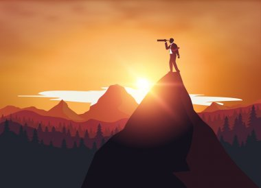 Businessman standing on top mountrain looking through binoculars