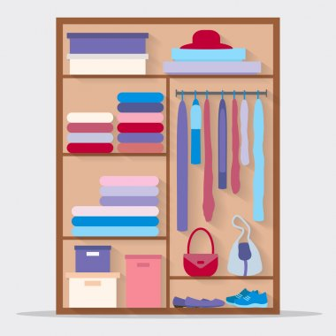 Closet with clothes, bags, boxes and shoes