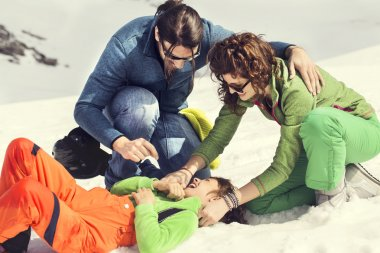 Family pampering their son on the snow
