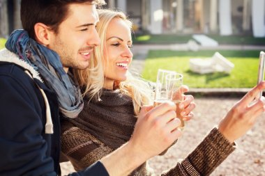 couple in love gets a Selfie while drinking aperitif