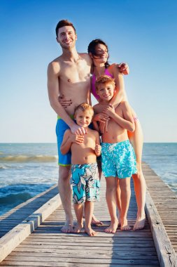 Happy Family Standing on Wooden Pier