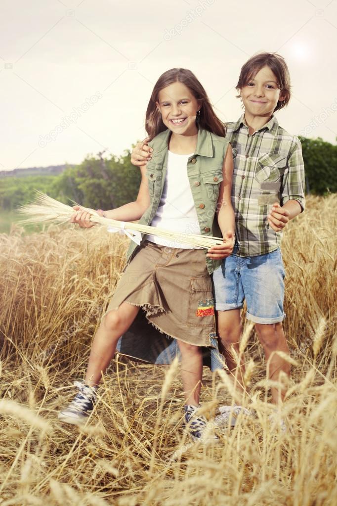 Young boys having fun in the wheat field