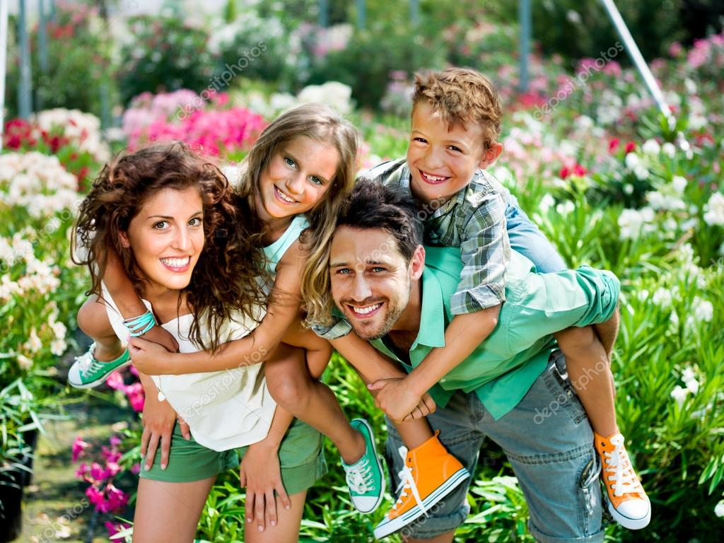 Happy family posing for a picture in a greenhouse