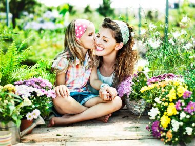 Mom and daughter have fun in the work of gardening