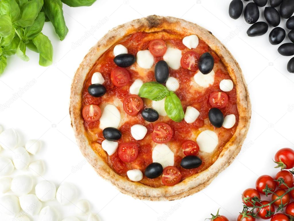 Italian pizza with tomato, mozzarella, basil and olives