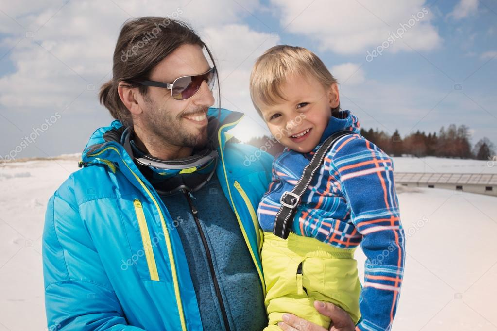 Father and son having fun in the snow