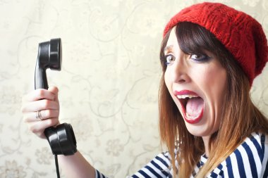 Pin-Up girls screaming on vintage phone