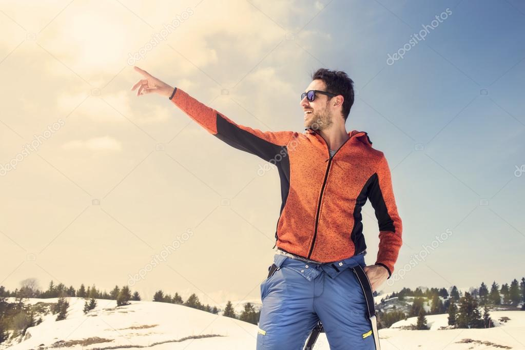 Man indicates infinity in the mountains
