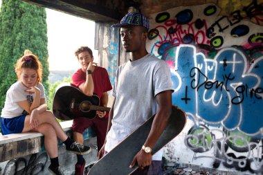 musician friends having fun in an urban place