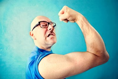 crazy man showing  proudly  its muscles