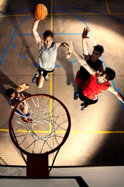 young basketball players playing with energy
