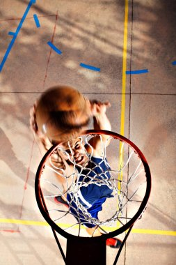young basketball player playing with energy
