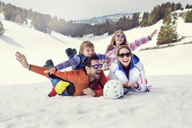 Happy family having fun in the snow