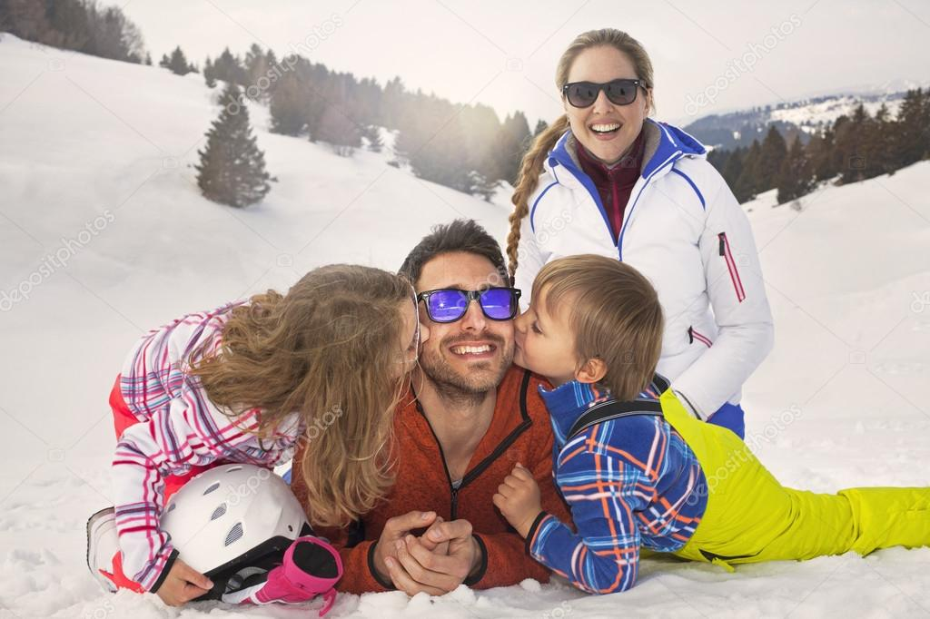 Children and their parents in natural affection on the snow