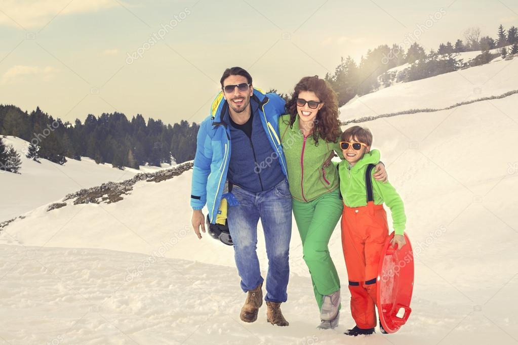 Happy family walking on the snow