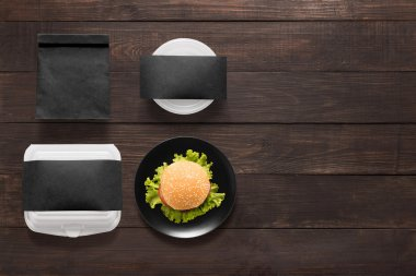 Black concept burger set on wooden background. Copy space for te