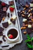 Different varieties of chocolate. White,milk and dark and liquid chocolate .