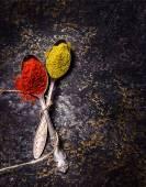 Fotografie Spices on dark stone background.