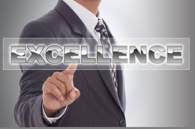 Businessman hand touching excellence word
