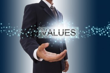 Businessman hand showing values button on virtual screen.