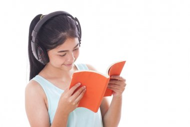 Young women reading book and listening music
