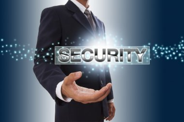 Businessman hand showing security button on virtual screen.