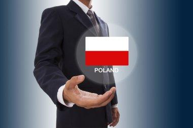 Businessman hand showing Poland Flag