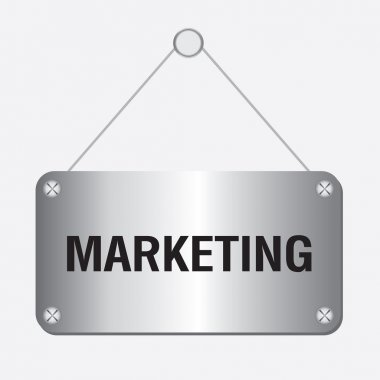 Silver metallic marketing sign hanging on the wall