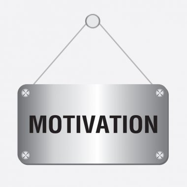 Silver metallic motivation sign hanging on the wall