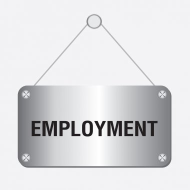Silver metallic employment sign hanging on the wall