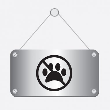 Silver metallic no dog paw sign hanging on the wall