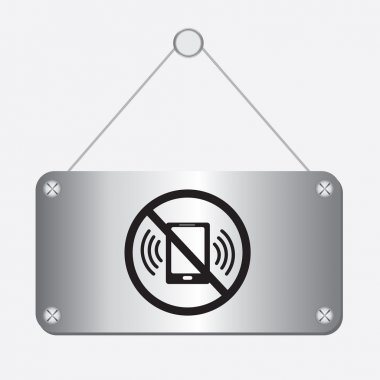Silver metallic no phone sign hanging on the wall