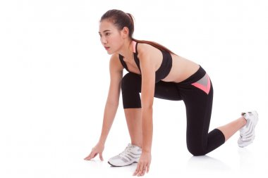 woman in position to start running. on white background