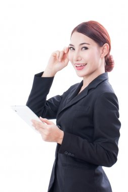 Portrait of young business woman using tablet and thinking.