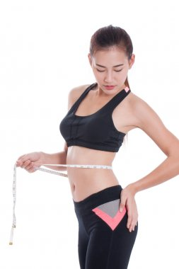 Fitness woman taking measurements of her body. healthy concept