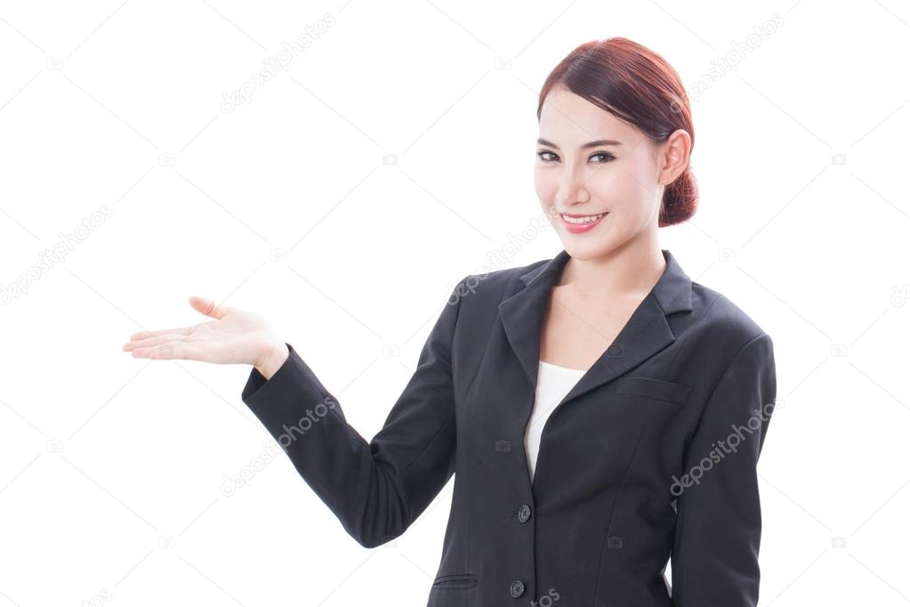 Smiling young businesswoman showing blank area for sign or copyspase