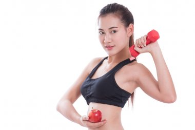Sport woman with lifting weights and holding apple. healthy concept