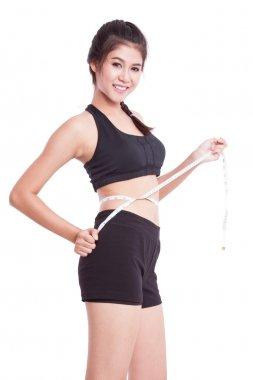 Fitness young woman with measuring tape