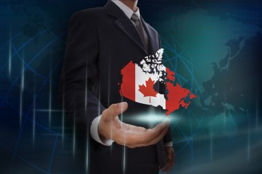 Businessman showing map of Canada
