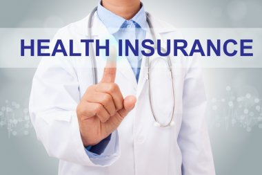 Doctor touching health insurance sign