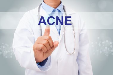 Doctor touching acne sign