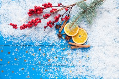 Christmas card. Spices, orange slices, Christmas tree and berrie
