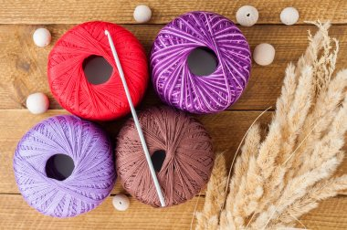 Yarn for knitting and wooden beads on a table. Accessories for k