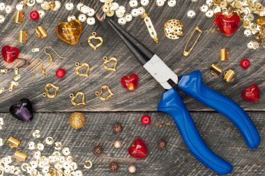 Tools for handmade jewelry. Beads, plier, glass hearts and acces