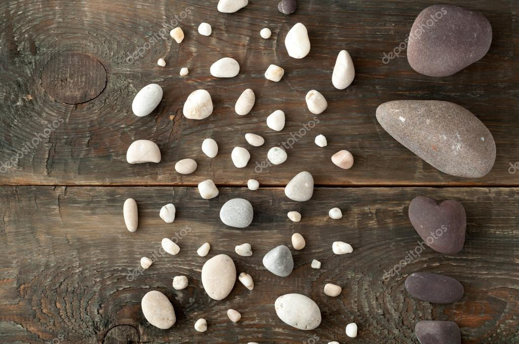 Sea stones on wooden background