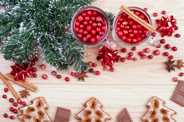 Christmas background. Tea with cranberries and cinnamon, cookies