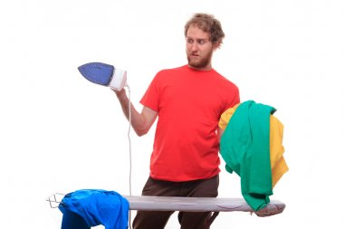 Embarrassed man irons clothes on board